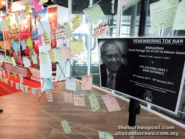 Condolence messages and words of comfort written on sticky notes are displayed in an area provided by Azam Youth Central for the general public at UTC Kuching.