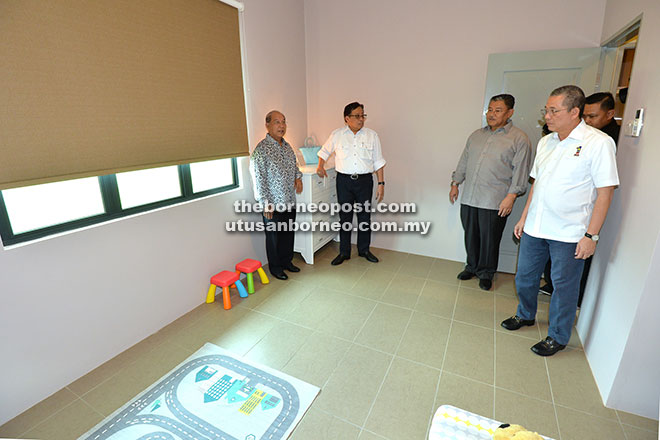 Abang Johari (second left) taking a look at one of the rooms of a housing unit at Taman Sri Maya. With him are Fadillah (right), Morshidi (second right) and Hamid (left). - Photo by Tan Song Wei