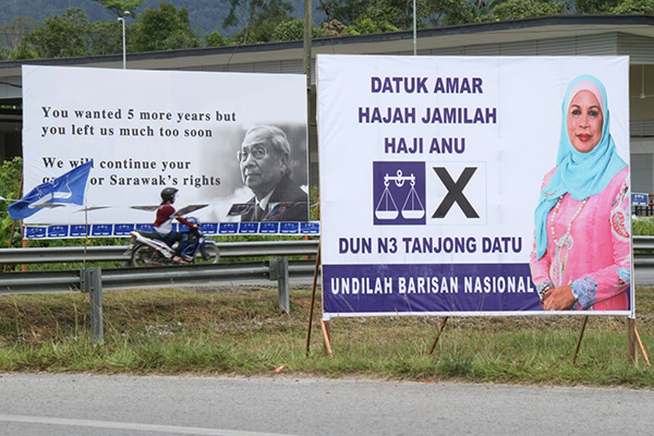 An election poster of Jamilah juxtaposed with that of her late husband and former Chief Minister Datuk Patinggi Tan Sri Tan Sri Adenan Satem. — Photo by Chimon Upon
