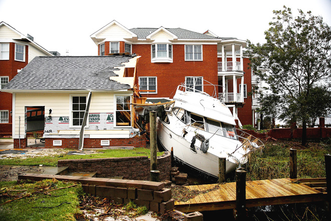 A boat sits in a backyard after the pass of Hurricane Florence in New Bern North Carolina.— Reuters