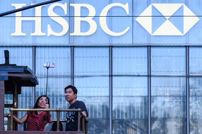 HSBC profits rise in 2019 but last quarter hit by trade