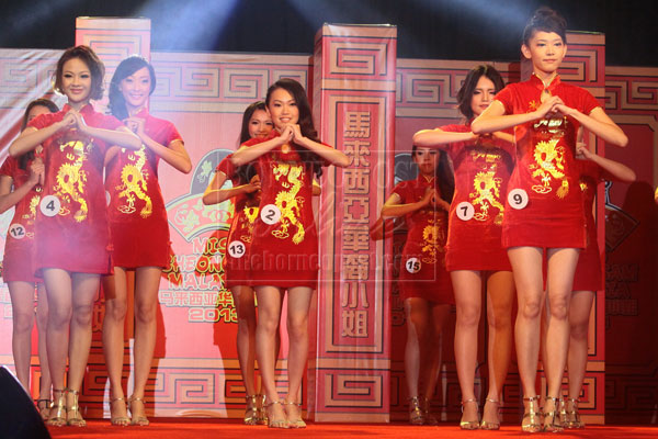 GONG XI FA CAI: Contestants of the Miss Cheongsam Malaysia 2013 perform a Lunar New Year song.