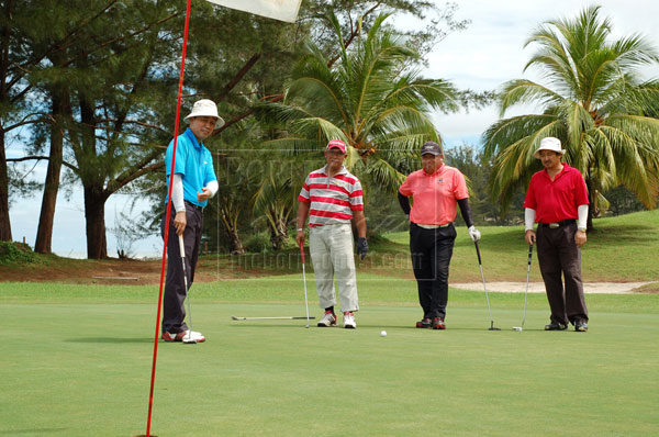 THIS IS LIFE: A file photo of golfers at Damai Golf & Country Club (DGCC) trying out at the newly improved green at Hole 17.