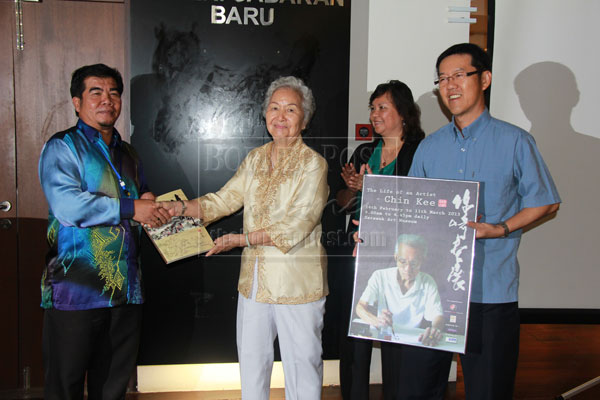FOR YOU: Bong (second left) hands over a book as souvenir to Ipoi as Helen (second right) and Hong look on.