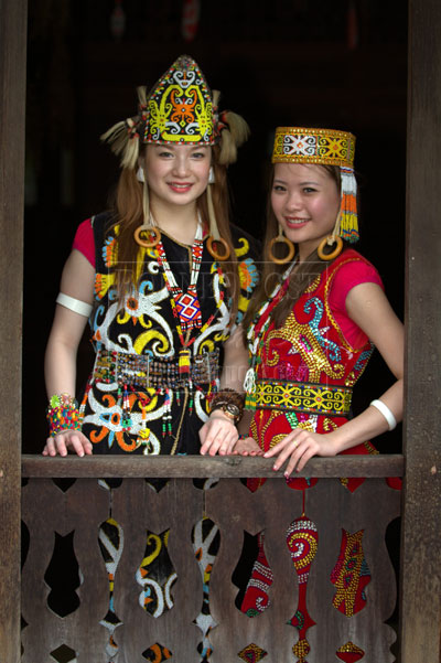 LOOKING GOOD: Two contestants model traditional costumes.