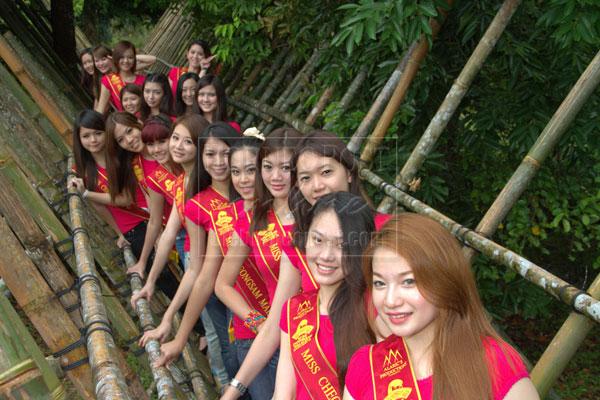THE LINE-UP: Miss Cheongsam Malaysia 2013 finalists pose on a bamboo bridge.