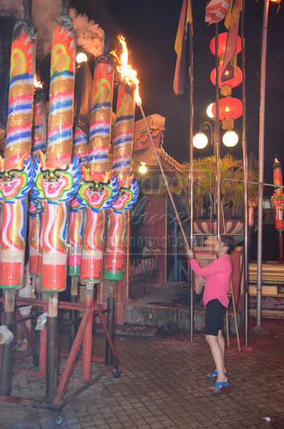 NIGHT TO REMEMBER: The colours and sounds at the temple draw thousands of tourists.