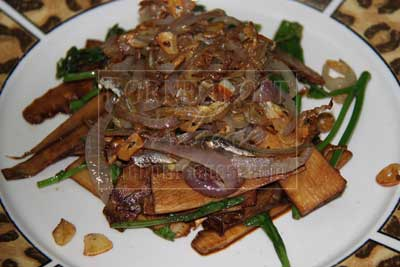 SAVOURY: Tepus, boiled-bamboo shoot and sawi Dayak fried with dried anchovies and slices of red onion and garlic with soya sauce.