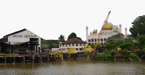 GLIMPSES OF THE PAST: The old State Mosque and the Brooke Dockyard are some of the historical buildings along Sungei Sarawak.