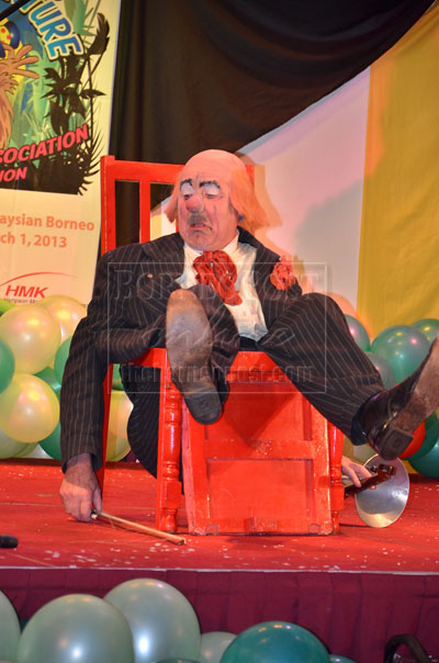 OOPS, WHAT HAPPENED: A clown    balanced himself as he sat on a 'malfunctioning' chair during an act that night.