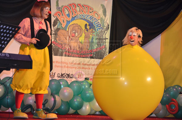 WRAPPED IN A BALLOON: Two Japanese clowns performing an act which saw one of them having the body fitted onto the balloon.