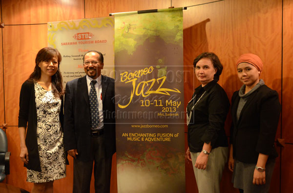 MUSIC ADVENTURE: Rashid (second left) with STB's director of corporate communications Angela Bateman (second right), Yeah (left) and project event manager Qarmilla Chin Abdullah after the ribbon cutting ceremony to launch the Borneo Jazz Festival 2013. — Photo by Karen Bong