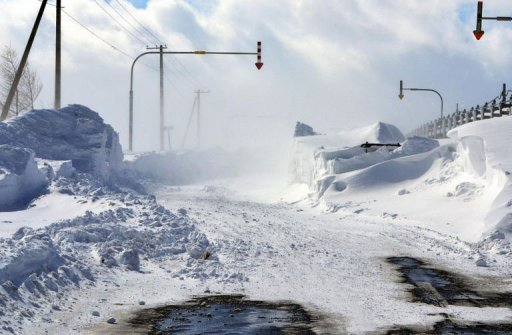A road in Nakashibetsu town on Hokkaido island is seen covered in snow on March 3, 2013 after severe weekend blizzards sweep northern Japan. At least nine people died in snow-related incidents in Hokkaido over the weekend, including a father who froze to death while sheltering his nine-year-old daughter, reports said Monday. -AFP photo