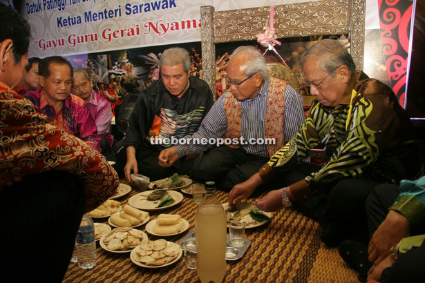 (From right) Adenan, Jabu and Awang Tengah at the 'miring'  ceremony at the start of the pre-Gawai celebration at Lawas Indoor Stadium.