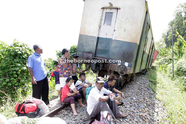 Some of the stranded passengers waiting for the train wagon service.