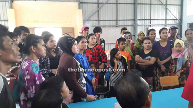 A section of the illegal Suluk immigrants who surrendered themselves at Kampung Lereng Bukit last April.