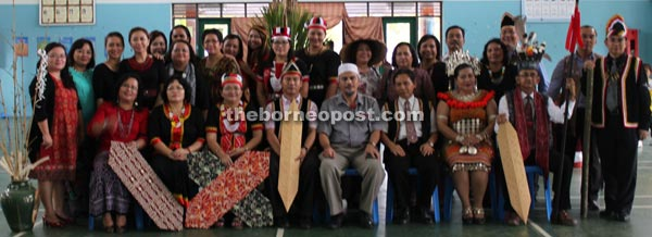 The Dayak community with Affandi (seated fifth left).