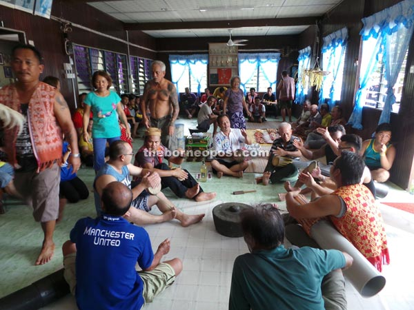 A typical scene of Gawai celebration taking place on the 'ruai' of the longhouse.