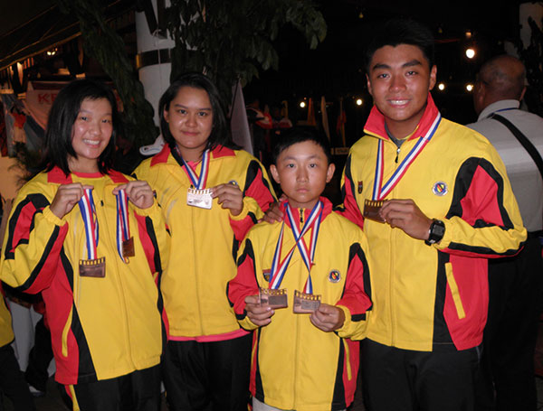 State golfers (from left) Ashley Lau, Jaclyn Chen (girls U-18), Matthew Peregriine Ong and Jordan Tay pose with their medal during last year's MSSM Golf Championship.