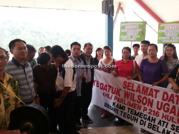 PRS women and supporters holding placards to welcome Ugak (centre) at Kapit Express Wharf Terminal.