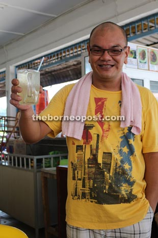 Kopitiam owner Chua proudly presents his 'GS-Tea.'