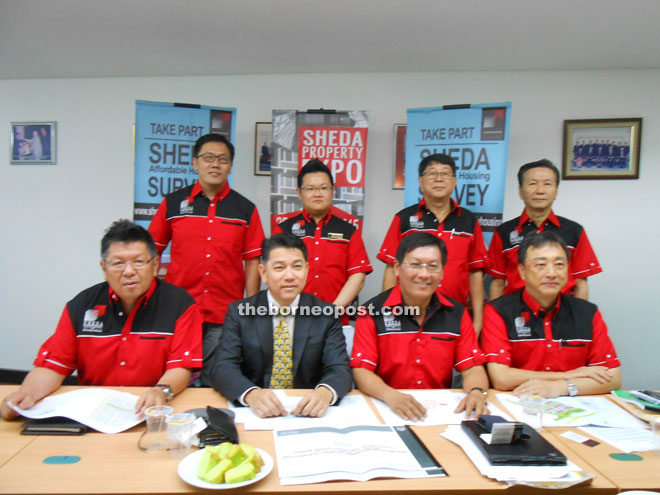 Wong (sitting, second right) with other members of Sheda at the press conference showing some of the development proposals.