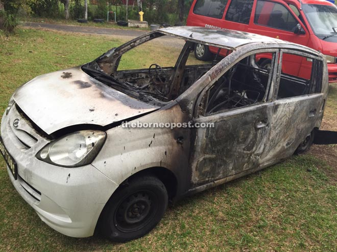 The Perodua Viva car that was destroyed in the fire at Kampung Bambangan, Papar yesterday.