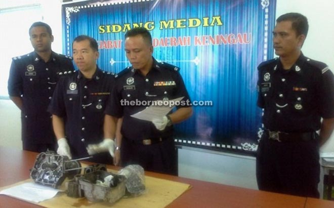 Douglas (second right) with CID chief ASP Lee Nyuk Kim (second left) and investigating officers showing the motorcycle engine components seized from the suspect.