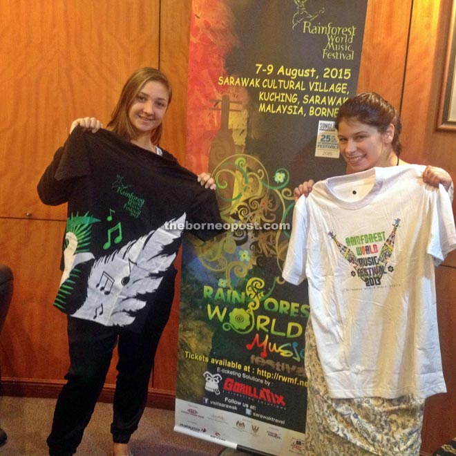 Happy buyers with their respective free festival T-shirts.