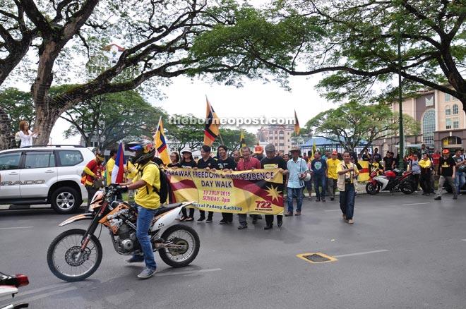 Participants prepare to begin the mini parade at Padang Merdeka.