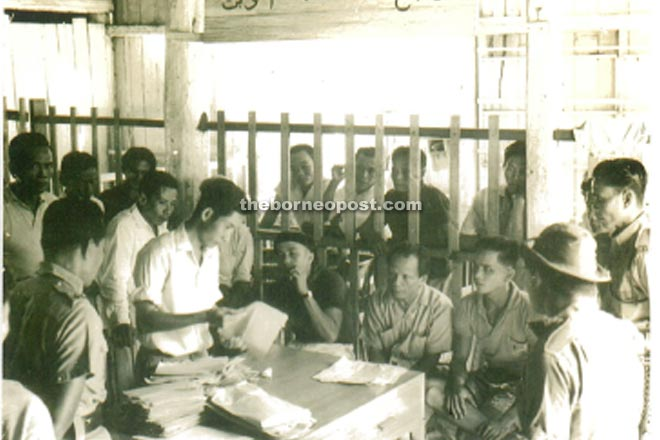 1963 counting of votes, Belaga 1963. Seated - Candidate Matu Puso (left) and Datuk Nyipa (right).