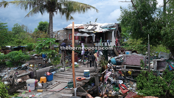 The house of one of the many families residing in the dump site.