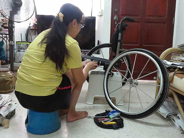Wuan has learnt to repair my wheelchair out of necessity.