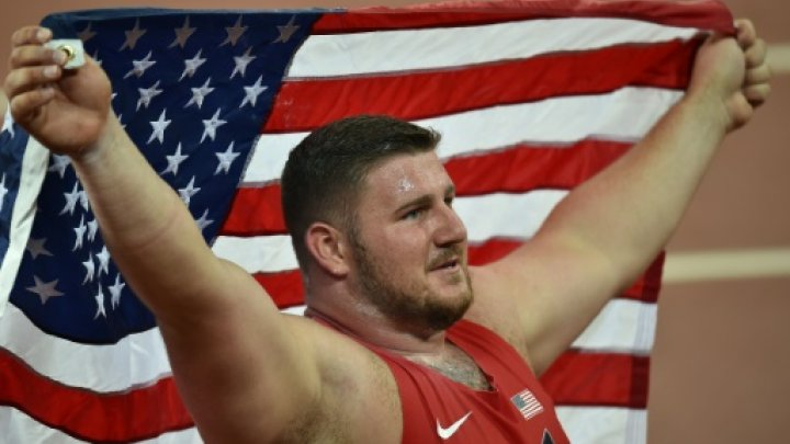 © AFP / by Alastair HIMMER | Joe Kovacs celebrates after winning the men's shot put world title in Beijing on August 23, 2015