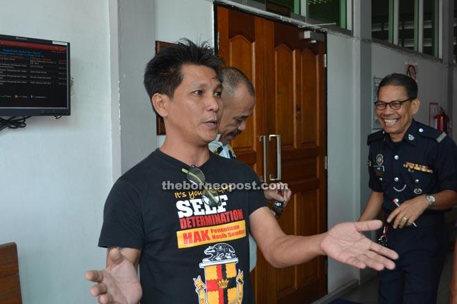 Yeu talks to pressmen outside the court.