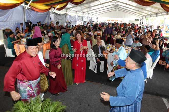 Awang Tengah joins in a traditional Malay dance together with other guests.