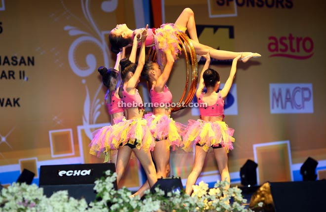 Members of a dance group lift a dancer during their performance. — Photo by Mohd Rais Sanusi.