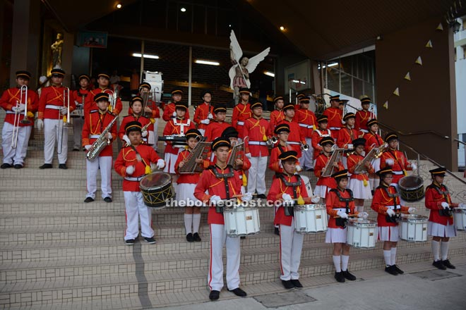 A school band adds colour up the celebration.