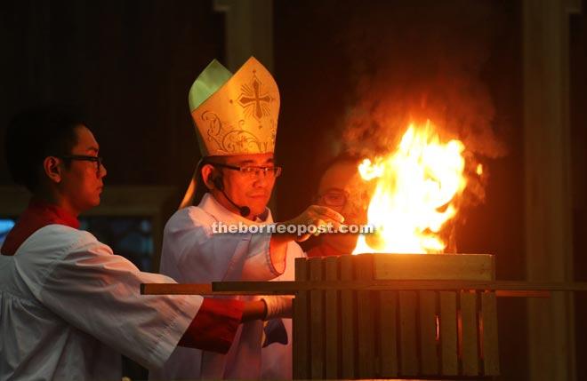 Bishop Hii incenses the altar.