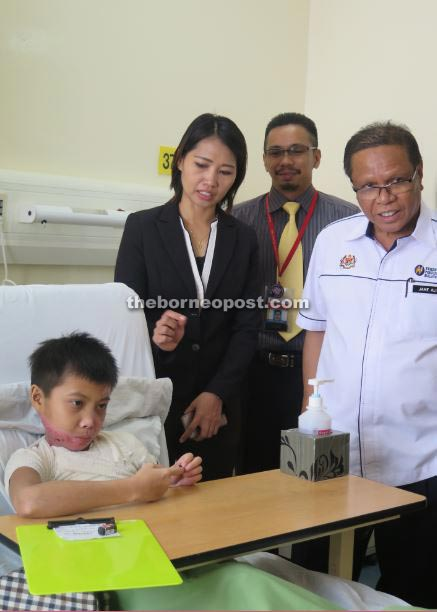 Jame (right) visits Alex at the Sabah Women and Children Hospital.