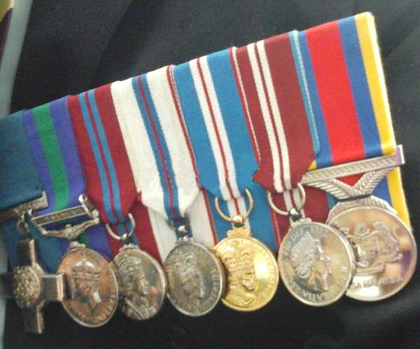 The awards for gallantry Awang received from the British government.
