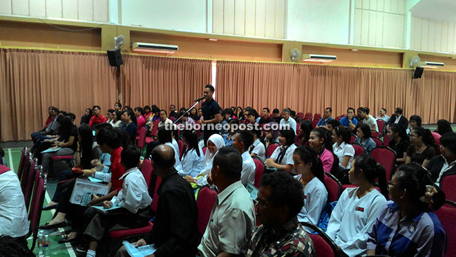 A participant asks a question during the seminar at DBNA hall.