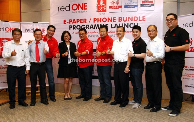 (From fifth left) Farid, Phyllis, RedONE chief operations officer Tee Yew Yaw, RedONE chief sales officer Ben Teh and See Hua Group Kuching area manager Wong Sing Seng (fourth right) gather for a photo call at the launch.