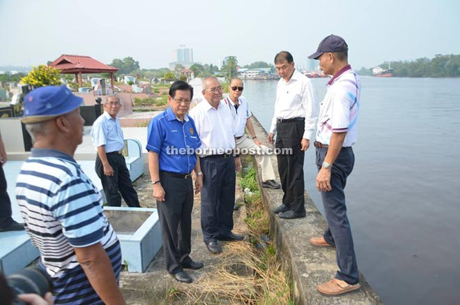 Lee (third left) and DID officers inspecting the cemetery retaining wall beside Miri river