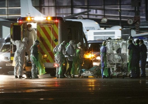© AFP/File | Pauline Cafferkey is led into a quarantine tent trolley before being airlifted to the Royal Free hospital in London after she was initially diagnosed with the Ebola virus in 2014