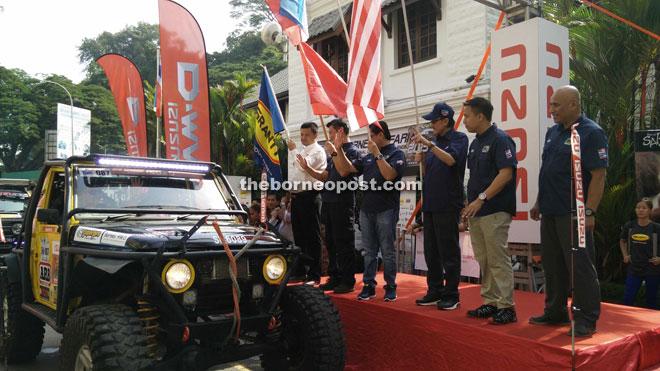 Masidi (third right) flagging off the Borneo Safari convoy.