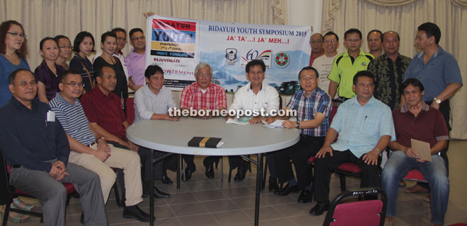 Minister of Infrastructure Development and Communication Dato Sri Michael Manyin Jawong (seated centre), who is DBNA and DGA chief advisor, and Ik (seated fourth right) are seen with the speakers, facilitators and organising committee members.
