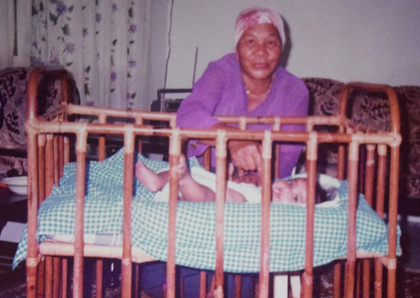 Linyang looking after her grandchild.