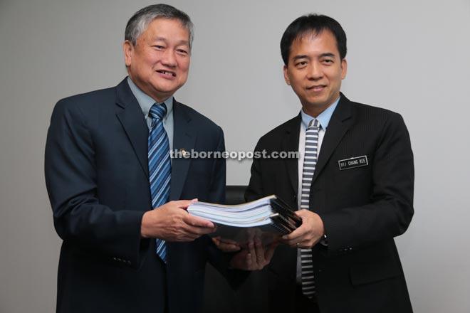 Sim (left) hands over duty to Hii.