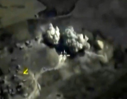 Russian Defence Ministry/AFP | Russian Defence Ministry footage purports to show airstrikes carried out by the Russian air force on an explosives warehouse in Raqqa last month